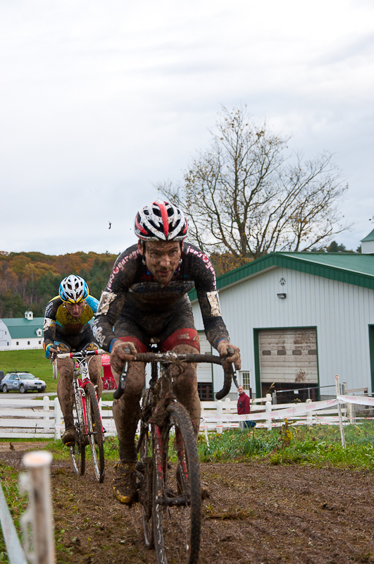 Justine Lindine, with Adam Myerson closing in, at a muddy Downeast cross in 2011. Photo: Dave Chiu.